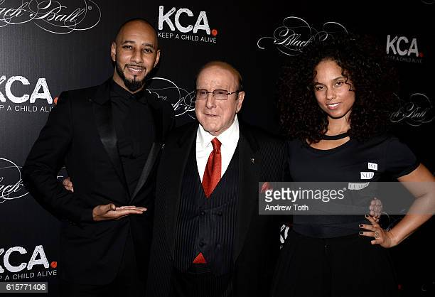 Swizz Beatz Clive Davis and Alicia Keys attend Keep a Child Alive's 13th annual Black Ball at Hammerstein Ballroom on October 19 2016 in New York City