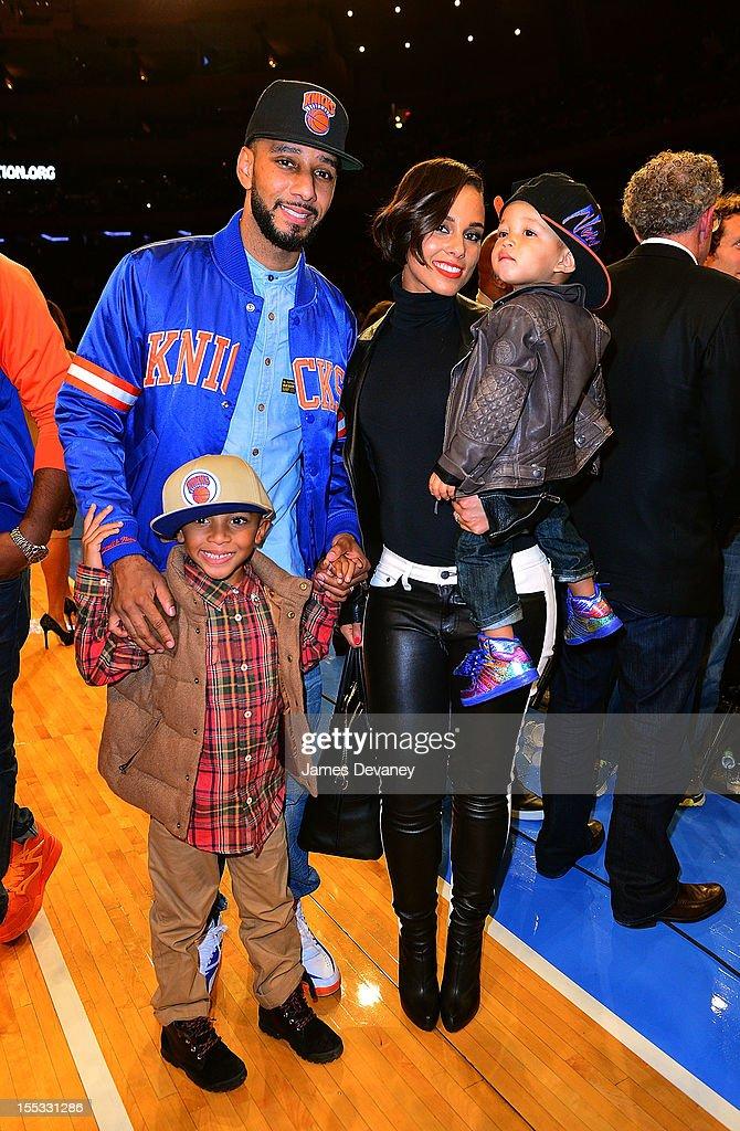 Swizz Beatz, Kasseem David Dean Jr, Alicia Keys and Egypt Dean attend the Miami Heat vs New York Knicks game at Madison Square Garden on November 2, 2012 in New York City.