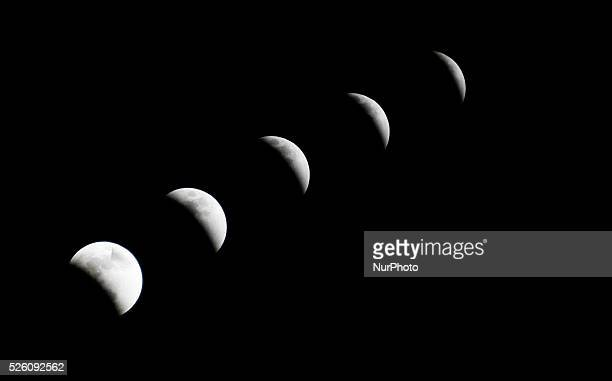 A swollen quotsupermoonquot is seen during the stages of an eclipse in Quito Ecuador on September 28 2015 For the first time in decades the double...