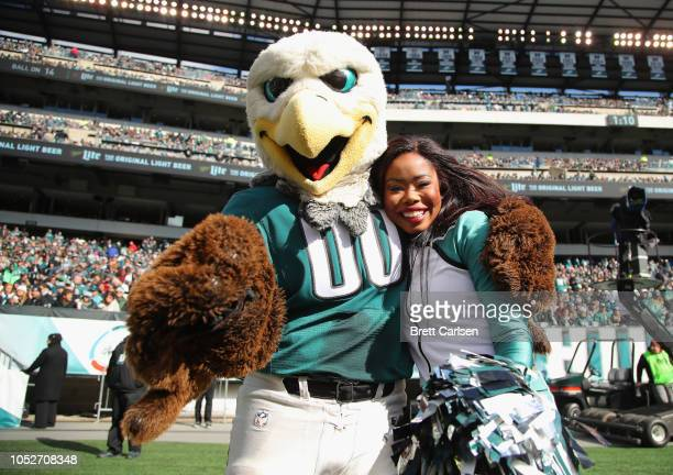 Swoop mascot for the Philadelphia Eagles takes a photo with a Philadelphia Eagles cheerleader as they take on the Carolina Panthers during the second...
