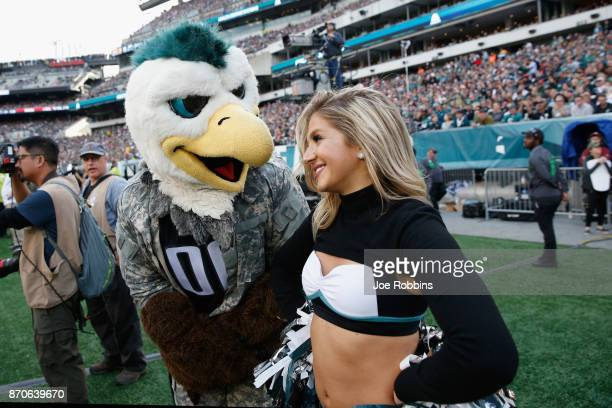 Swoop Philadelphia Eagles mascot talks with a cheerleader against the Denver Broncos during the fourth quarter at Lincoln Financial Field on November...