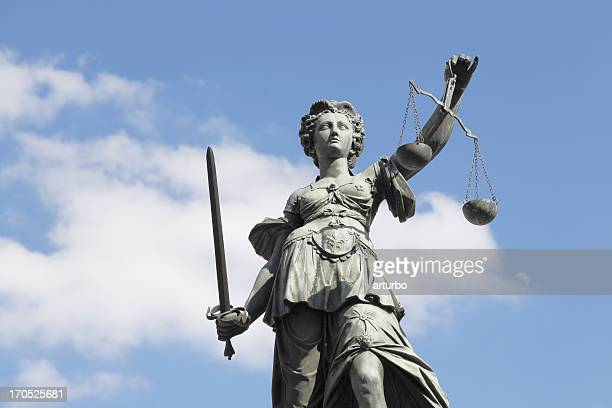 sword and cloudy  blue sky with ancient lady justice justitia - lady justice stock pictures, royalty-free photos & images