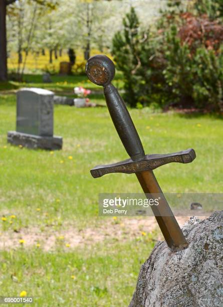 sword in tombstone - sword in the stone stock photos and pictures