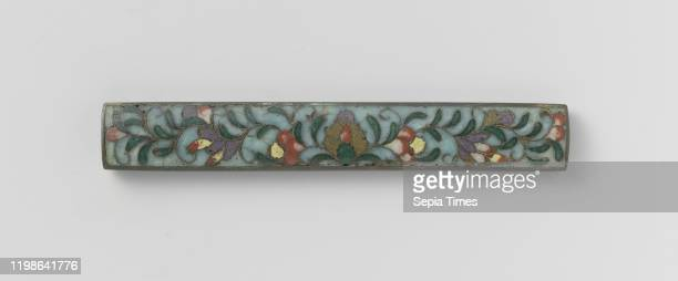 Sword knife hilt Top with cloisonne decoration a light blue background against which a floral decoration with green and purple leaves and...