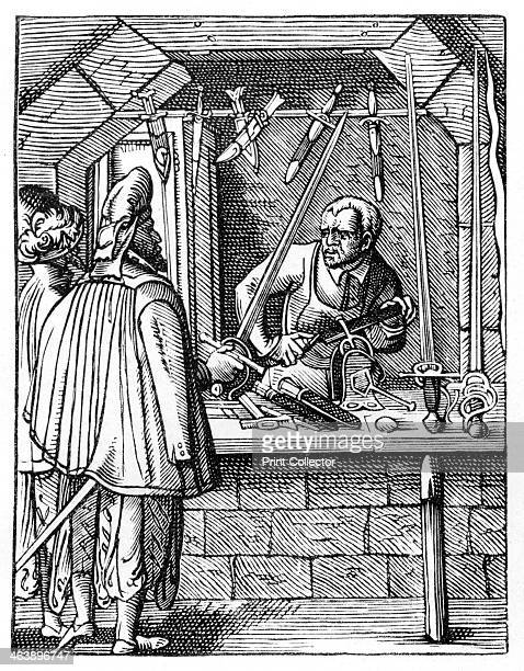 Sword maker c15591591 A craftsman at his workbench holds an item in a vice while he works on it with a file Around him are daggers and swords he has...