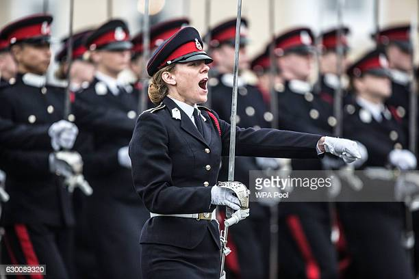 Sword of honour recipient Rosie Wild shouts commands as the Officer cadets march in review order during The Sovereign's Parade at Royal Military...