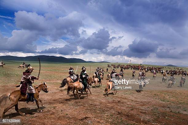 Sword wielding cavalry charge Genghis Khan's 800th anniversary Festival of Eurasia A reenactment of the unification of the Mongolian tribes under...