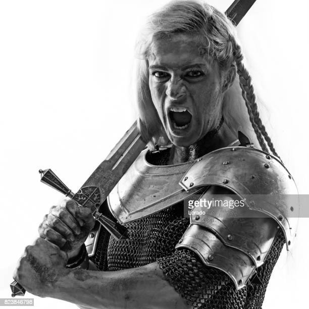 Sword wielding viking warrior female in studio shot