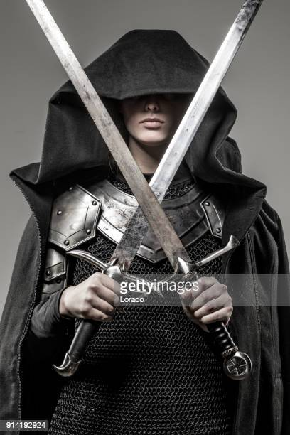 Sword wielding viking warrior young blond female in studio shot
