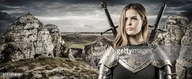 sword wielding viking warrior young blond female in wild highland countryside - princess stock pictures, royalty-free photos & images