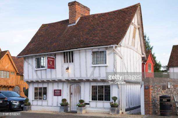 Sworders estate agents established in 1782 in timberframed house in Market Square in quaint historic town of Lavenham in Suffolk England United...