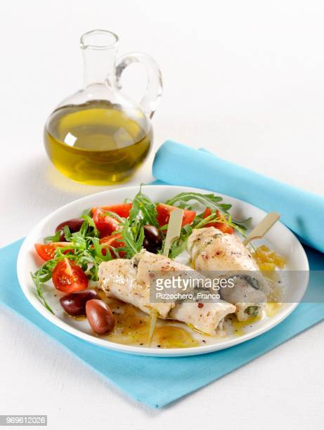 swordfish and pesto rolls with a tomato and rocket salad - swordfish stock pictures, royalty-free photos & images