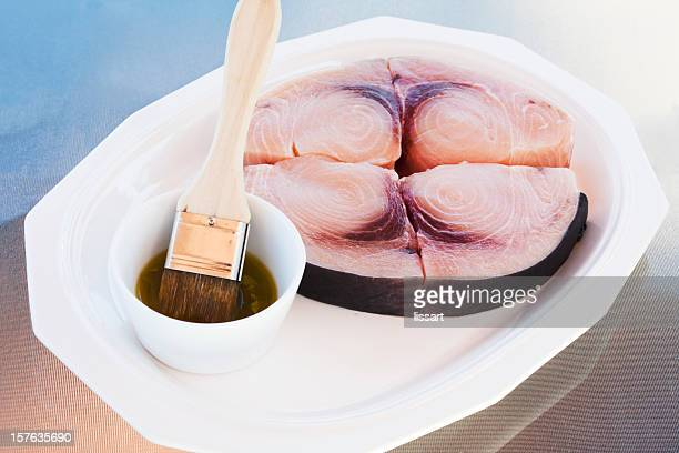 swordfish steaks ready to grill - basting brush stock photos and pictures