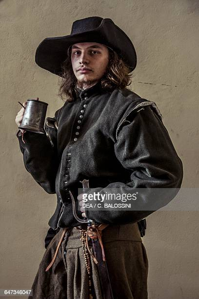 Swordsman with a widebrimmed hat and mug Italy 16th century Historical reenactment
