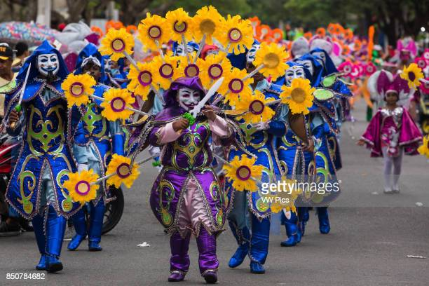 Swordsmen in sunflower costumes in the La Vega Carnival parade The first documented Carnival celebration in what is now the Dominican Republic was...