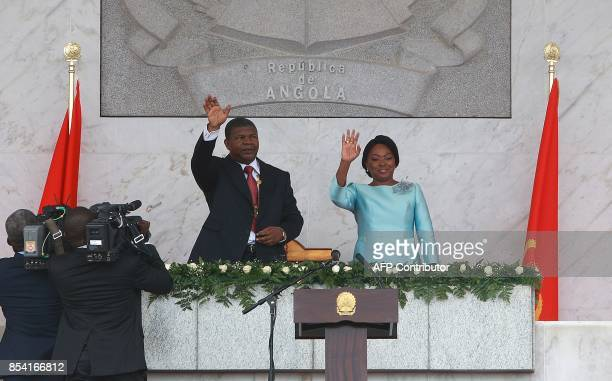 Sworn in Angolan President Joao Lourenco and his wife Ana Dias de Lourenco wave to the crowd at the end of his swearing in ceremony as the new...