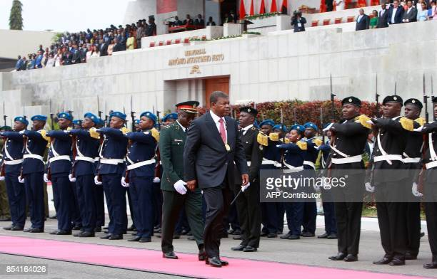 Sworn in Angolan President Joao Lourenco inspects a guard of honour at the end of his swearing in ceremony as the new Angolan President on September...
