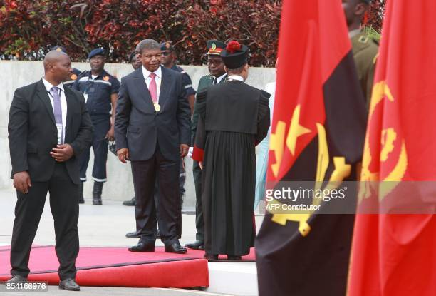 Sworn in Angolan President Joao Lourenco looks on at the end of his swearing in ceremony as the new Angolan president on September 26 2017 in Luanda...