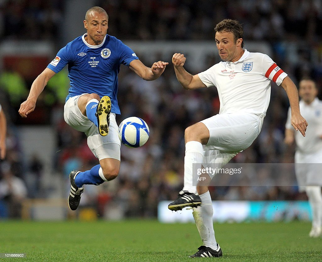 Swreden's Henrik Larrson (L) vies with British tv presenter Jonathan Wilkes during the Unicef Soccer Aid charity football match against the Rest of the world at Old Trafford in Manchester, north-west England on June 6, 2010. Soccer Aid is the brainchild of Robbie Williams and all money raised through profits from ticket sales and donations made by viewers of ITVduring the match will go to UNICEF�s invaluable work helping children around the world.