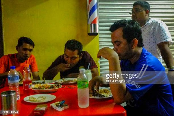 Syahrul having a dinner with his friends after he closed the grocery Malaysia count almost 17 million migrant workers in the country which Indonesian...
