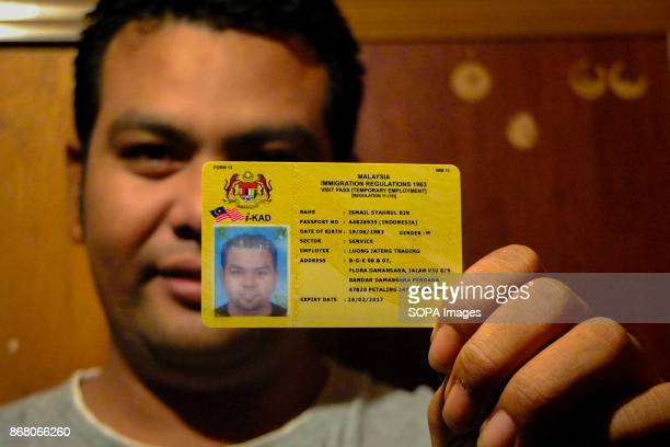 Syahrul holding his visa and working permit proudly He first arrived to Malaysia illegaly and after he made a sufficient money then he made all the...