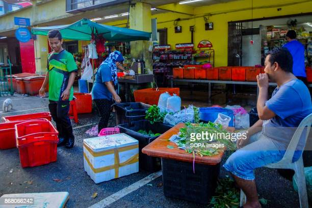 Syahrul is seen having a cigarette while helping his Indonesian coworkers at the grocery Malaysia count almost 17 million migrant workers in the...