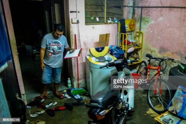 Syahrul is seen ready to start his work day at the grocery shop Malaysia count almost 17 million migrant workers in the country which Indonesian are...