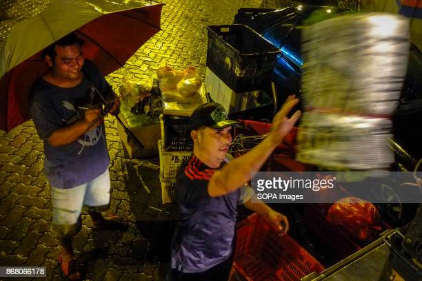 Syahrul is seen while helping his Indonesian coworker after he arrived at the wholesale market to deliver the vegetables Malaysia count almost 17...