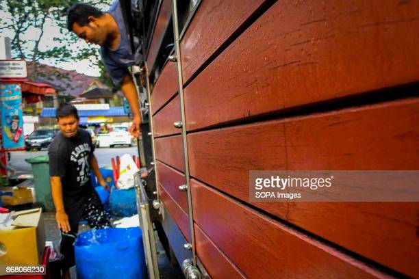 Syahrul is seen while helping his Indonesian coworker after he arrived at the wholesale market Malaysia count almost 17 million migrant workers in...