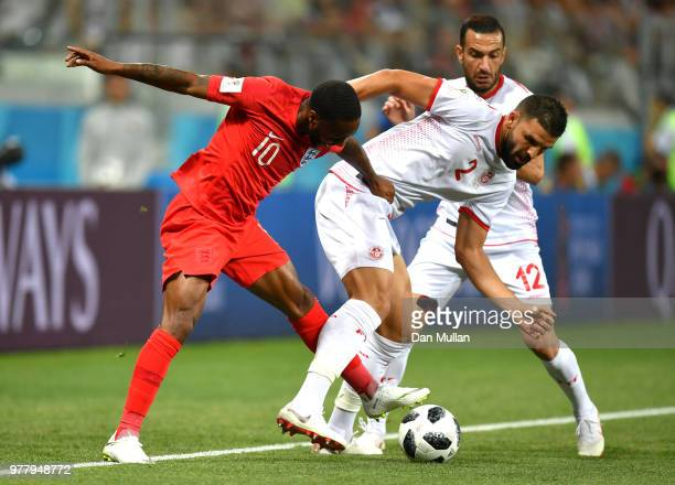 Syam Ben Youssef of Tunisia tackles Raheem Sterling of England during the 2018 FIFA World Cup Russia group G match between Tunisia and England at...
