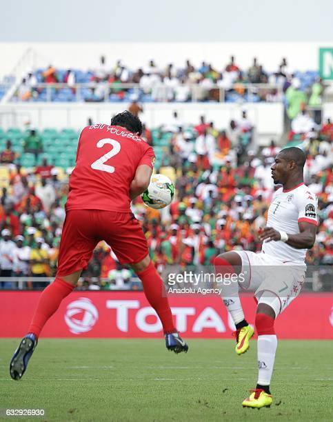 Syam Ben Youssef of Tunisia vies with Prejuce Nakoulma of Burkina Faso during the 2017 Africa Cup of Nations quarterfinal football match between...