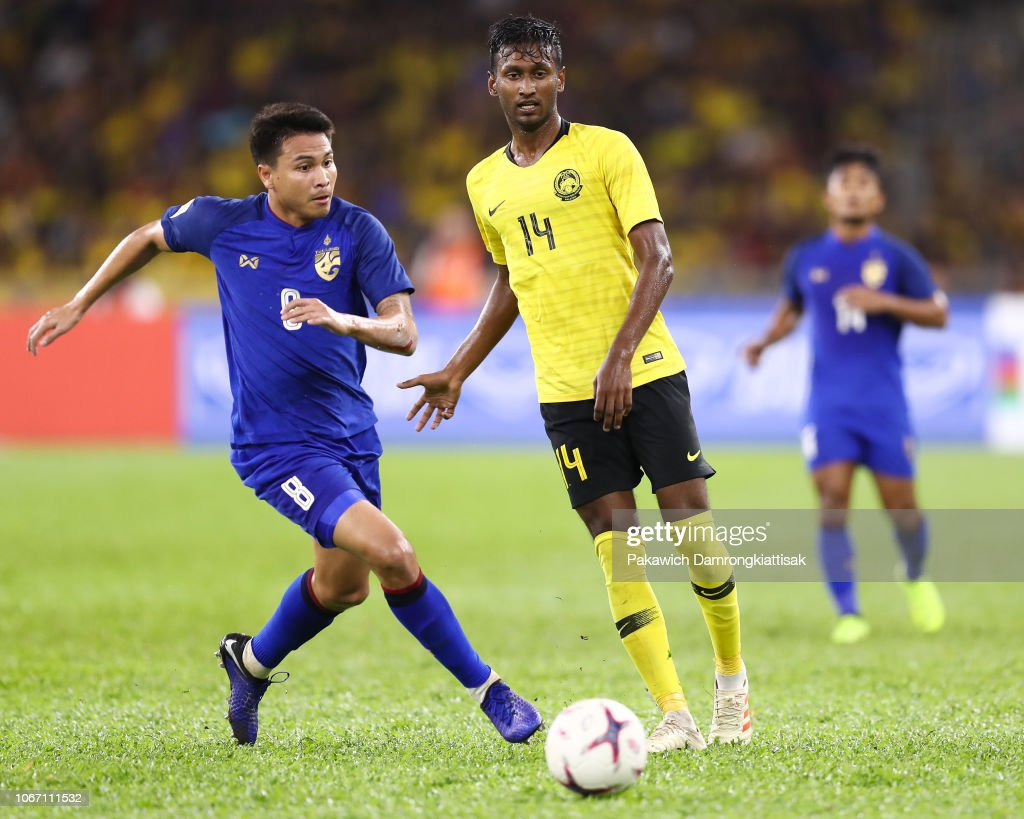 Syamer Kutty Abba of Malaysia controls the ball under pressure of ...
