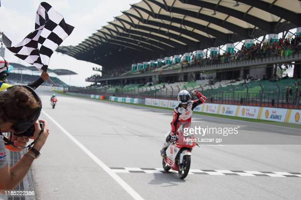 Syarifuddin Azman of Malaysia cuts the finish lane and celebrates the victory at the end of the race 2 Asian Talent cup during the MotoGP of Malaysia...