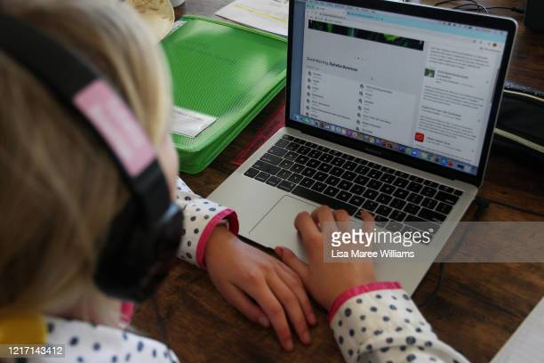 Sybella Bowman does school work at her family home and cattle property on April 05, 2020 in Tarpoly Creek, Australia. Emily Bowman, mother of three,...