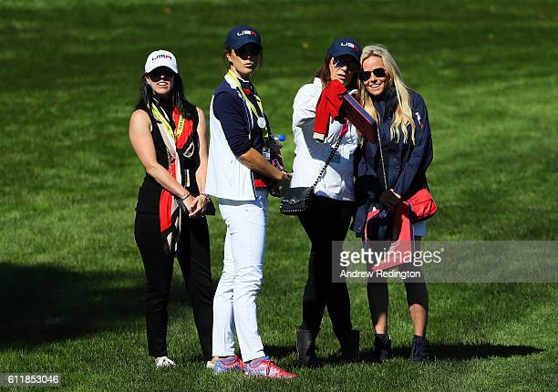 Sybi Kuchar and Amy Mickelson look on during afternoon fourball matches of the 2016 Ryder Cup at Hazeltine National Golf Club on October 1 2016 in...