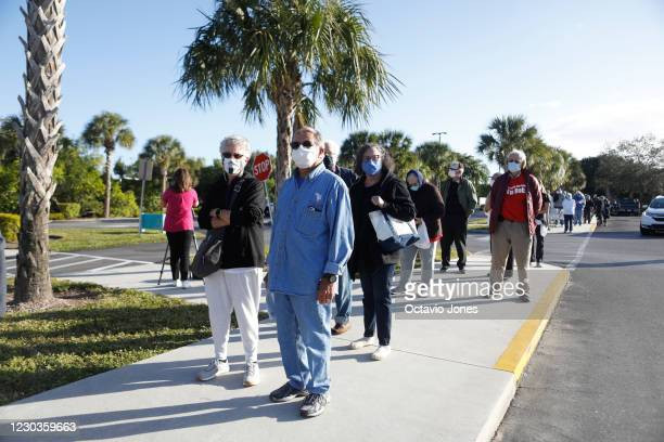 Sybil Appell and her husband Stuart wait in line to receive a COVID-19 vaccine at the Lakes Regional Library on December 30, 2020 in Fort Myers,...