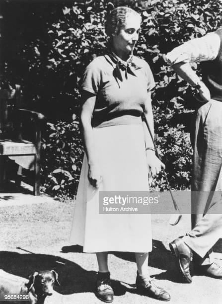 Sybil Cholmondeley Lady Cholmondeley holding a golf club circa 1940