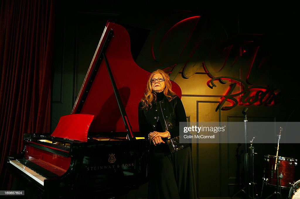 Sybil Walker in her new club called the Jazz Bistro on Victoria Street in Toronto. The club is a newly opened jazz club with three stories of space and an old one of a kind piano on the main floor.
