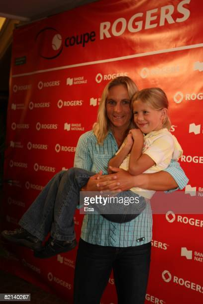 Sybille Bammer of Austria and her daughter Tina arrive for the WTA Tennis fashion show part of the Rogers Cup Tennis Tournament at the Fairmont Queen...