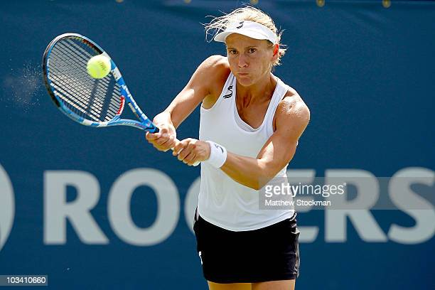 Sybille Bammer of Austria returns a shot to Alexandra Dulgheru of Romania during the Rogers Cup at Stade Uniprix on August 16 2010 in Montreal Canada