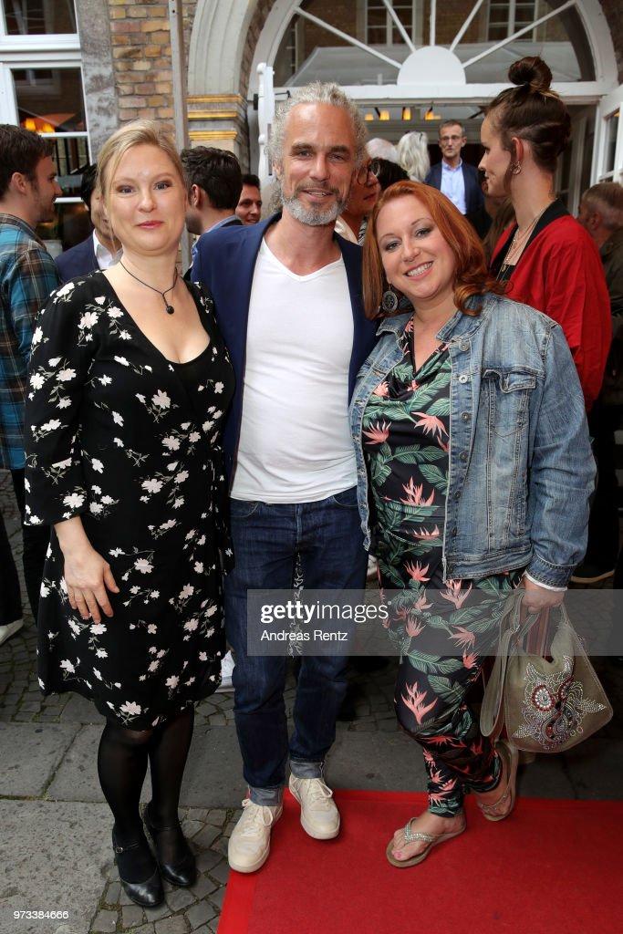 Sybille Waury, Moritz Zielke and Rebecca Siemoneit-Barum attends the 'Film- und Medienstiftung NRW' summer party at Wolkenburg on June 13, 2018 in Cologne, Germany.