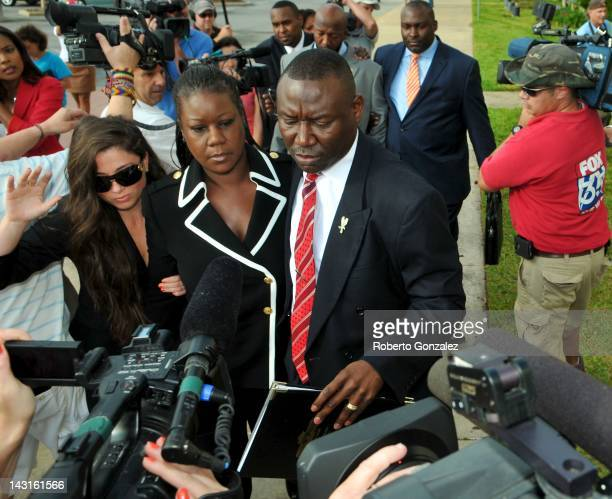 Sybrina Fulton , mother of Trayvon Martin, walks beside her attorney Benjamin Crump while the father Tracy Martin walks behind, as they enter...
