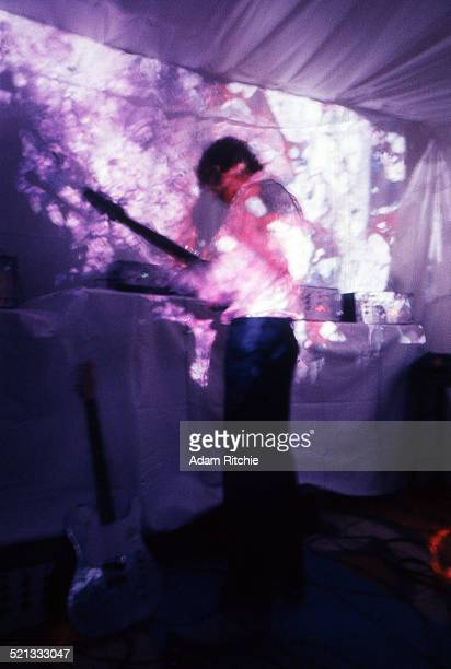 Syd Barrett of Pink Floyd performs under psychedelic lighting at the Architectural Association student party London 16th December 1966