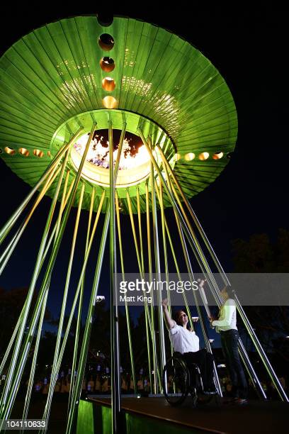 Sydney 2000 Paralympic Games gold medallist Louise Sauvage and Sydney 2000 Olympic Games gold medallist Cathy Freeman relight the Olympic Cauldron as...