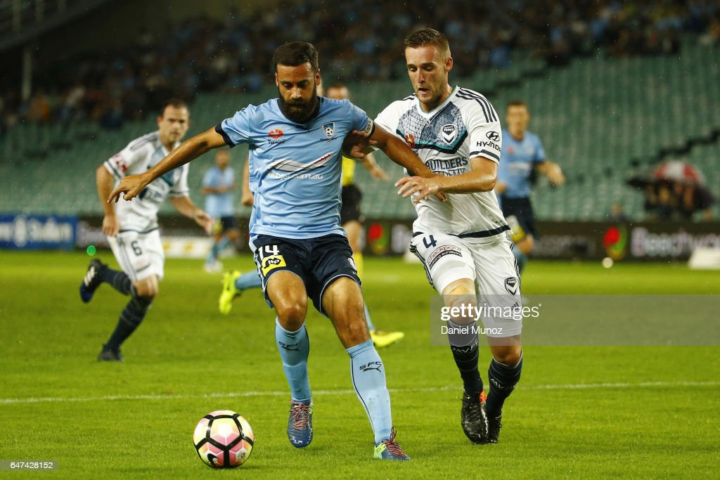 Sydney Alex Brosque fights for the ball against Nicholas Ansell during the round 22 A-League match between Sydney FC and Melbourne Victory at Allianz Stadium on March 3, 2017 in Sydney, Australia.