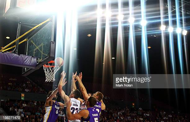 Sydney and Adelaide players attempt to rebound during the round ten NBL match between the Sydney Kings and the Adelaide 36ers at Sydney Entertainment...