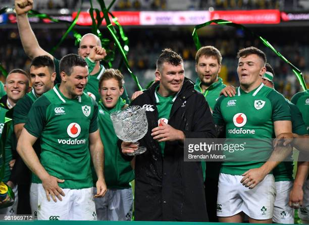 Sydney Australia 23 June 2018 Ireland captain Peter O'Mahony centre and teammates Jonathan Sexton and Jacob Stockdale with the Lansdowne Cup after...