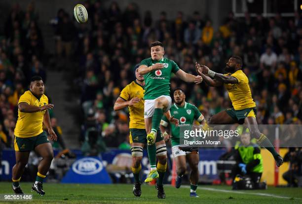 Sydney Australia 23 June 2018 Jacob Stockdale of Ireland contests a high ball with Marika Koroibete of Australia during the 2018 Mitsubishi Estate...