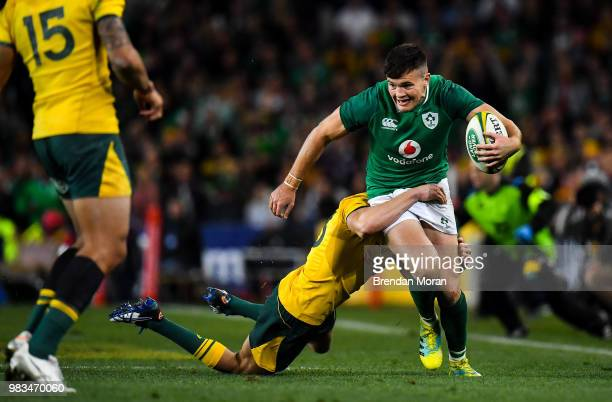 Sydney Australia 23 June 2018 Jacob Stockdale of Ireland is tackled by Reece Hodge of Australia during the 2018 Mitsubishi Estate Ireland Series 3rd...