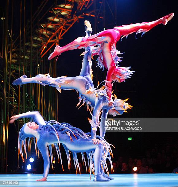 Acrobats perform a triple balancing act during the final dress rehearsal for Cirque du Soleil's 'Varekai' on the eve of its Australian premier in...